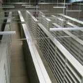 Static adjustable steel shelving located upon a mezzanine floor