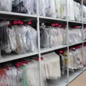 Garment Storage within adjustable steel shelving.