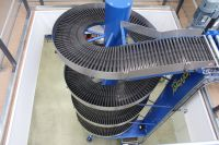 Spiral Conveyors x 2 for smooth transportation of  plastic totes between floor levels