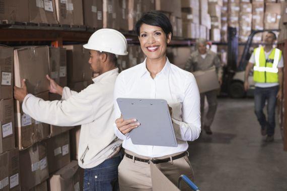 Warehouse manager writing on clipboard - istock 000047248332 medium