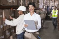 Warehouse manager writing on clipboard - istock 000047248332 medium
