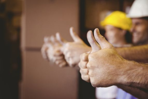Thumbs up in warehouse -istock 000048418474 xxxlarge