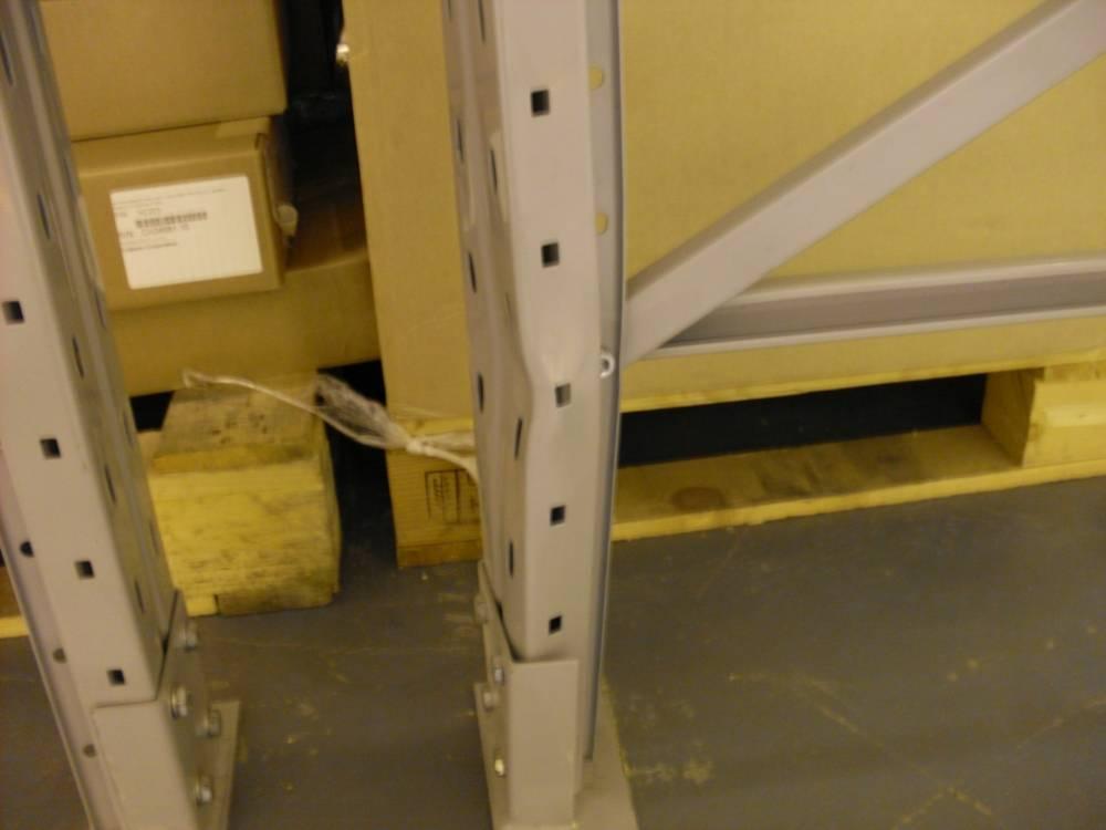 Damaged pallet racking structure